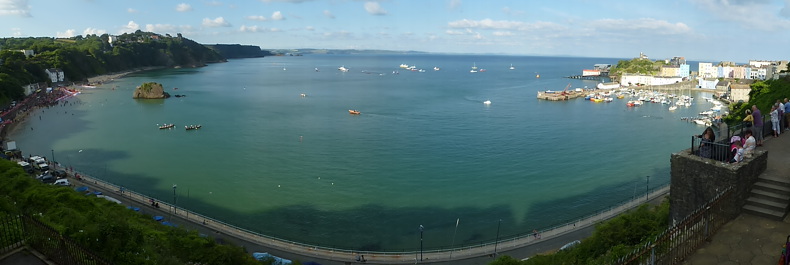 Tenby Harbour with swimmers waiting in the pen on the left hand side
